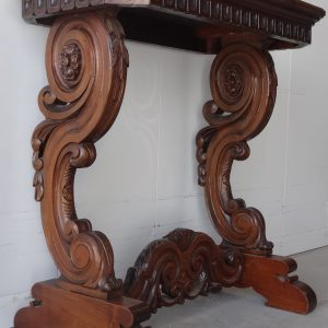 Heavily carved side table