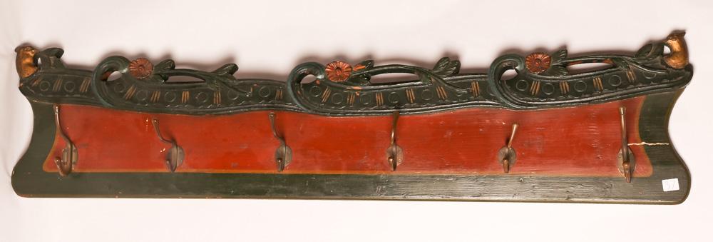 37   Coat rack.  Folk art.  Hand     carved oak in floral and bird  motif.  Dutch origin.    Late  19th century.