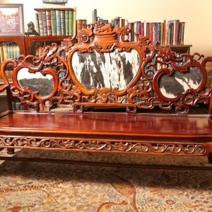 25.  Chinese rosewood sofa. Hand carved in dragon motif and with marble inserts. Mid 20th century.