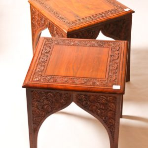 60.  Indian teak side tables. In-carved in floral motif with Persian style arches. Late 20th century.
