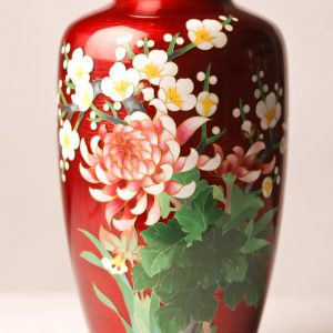 92.  Chinese cloisonné vase. With red ground and floral motif. Late 20th century.