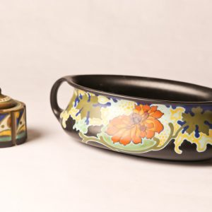38.  Gouda porcelain bowl. Black ground with floral design. Double handled. With similar incense burner. Two pieces. Mid 20th century.