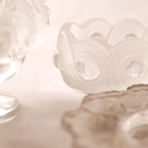 4.  Lalique collection. Vase with birds (minor chip); pin tray with leaves; bowl with round geometrics. Three pieces.