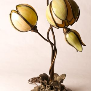 18.  Art Nouveau table lamp. Possibly bronze with green leaded glass shades in tulip form. Mid 20th century.