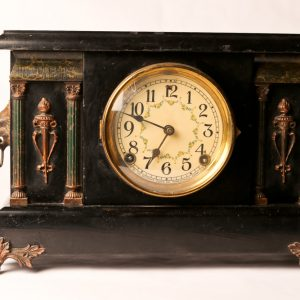 52.  Mantle clock. Sessions Company. With brass mounts and ebonized case. Early 20th century.