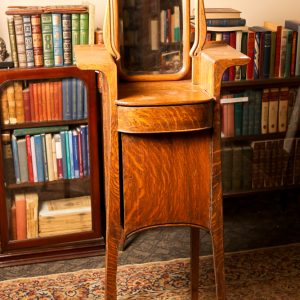 45.  Solid oak shaving stand. Swivel mirror above one shelf and one drawer and lower full door. Late 19th century.