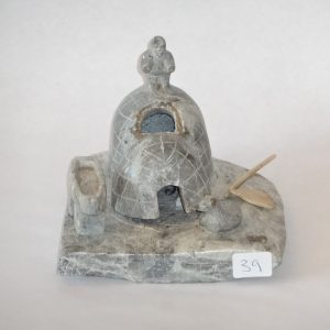 Inuit soapstone grouping. Grey grained Igloo scene. Signed in syllabics.
