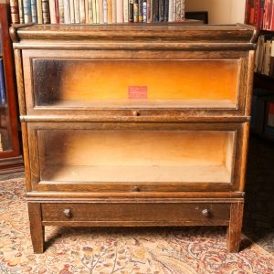 46. Barrister's bookcase.  Two tier, solid oak with glass doors and original brass mouldings.  With lower drawer.  Early 20th century.