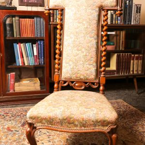 11. Hall chair.  Solid walnut, with pierced rail, Jacobean supports, cabriole legs and porcelain castors.  Mid 19th century.