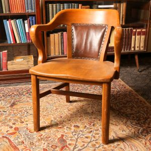 51. Office armchair. Solid oak with leather upholstery and brass tack trim. Early 20th century.