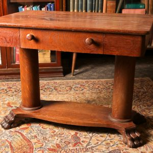 57. Antique sewing table. Solid 1/4 cut oak with slide-out basket. Early 20th century.