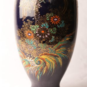 52. Porcelain flower vase.  Blue ground and hand painted floral decorations.  Probably English. Carlton Ware style.  Early 20th century.