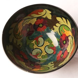 "17. Gouda bowl.  Large size with black ground and hand painted floral motif.  8"" D. Early 20th century."