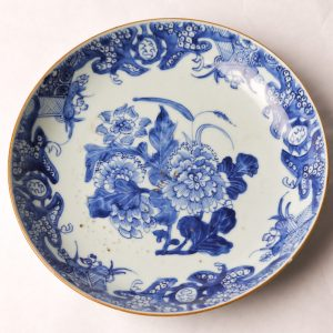 36. Chinese export porcelain charger. White ground and blue ink in peony and leaf design.  Ching Dynasty (Chien Lung period 1736-1795).  See accompanying paperwork.