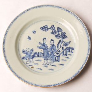 21. Chinese export porcelain plate.  White ground and blue ink depicting women and boy chasing butterflies.  Ching Dynasty (Chien Lung Period 1739-1795).  See accompanying paperwork.
