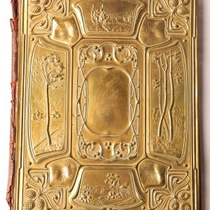 12. Art nouveau brass book cover.  Original leather back and hand embossed front. Early 20th century.
