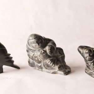 102. Three Inuit soapstone carvings. Mathewsie Amidlak woman and seal; Peter Etiodloie hunter; Martha Ekutisluk bird.