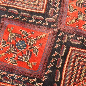 40. Persian Carpet.  Hand knotted wool.  Blue field with animal and geometric design. Early 19th Century.  *Note the Iranian import number (64812) determining it to be over 100 years old.