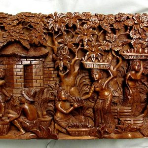 "72. Hardwood carving. Deeply undercut to give 3D effect. Complex village scene. 20""w."