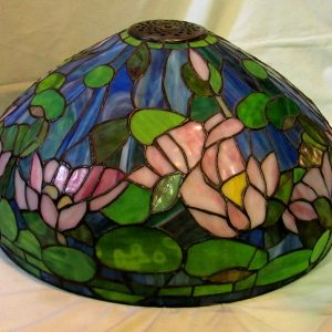 "47. Tiffany-type leaded glass shade. Over 300 glass pieces, mounted as floor lamp on solid turned walnut stand. 72"" h, 20"" diameter."