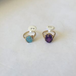 1. Two 14kt gold rings. One with centre opal, the second with simulant.