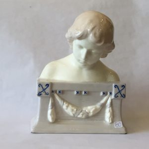 80a. Porcelain bust. Head and shoulders of a child on decorated plinth base.