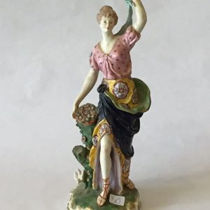 "50. Derby porcelain figure. Very high quality and detail.  Depicting a lady gathering flowers.  14H"".  Late 19th Century."