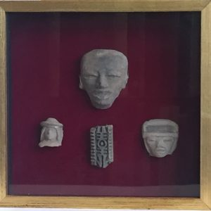 20. Collection of three hand carved faces and one pendant, in shadow box frame. Possible Mexican Aztec origin (Circa 1400AD). Purchased as authentic by a local collector for $100.00 in the 1970's.